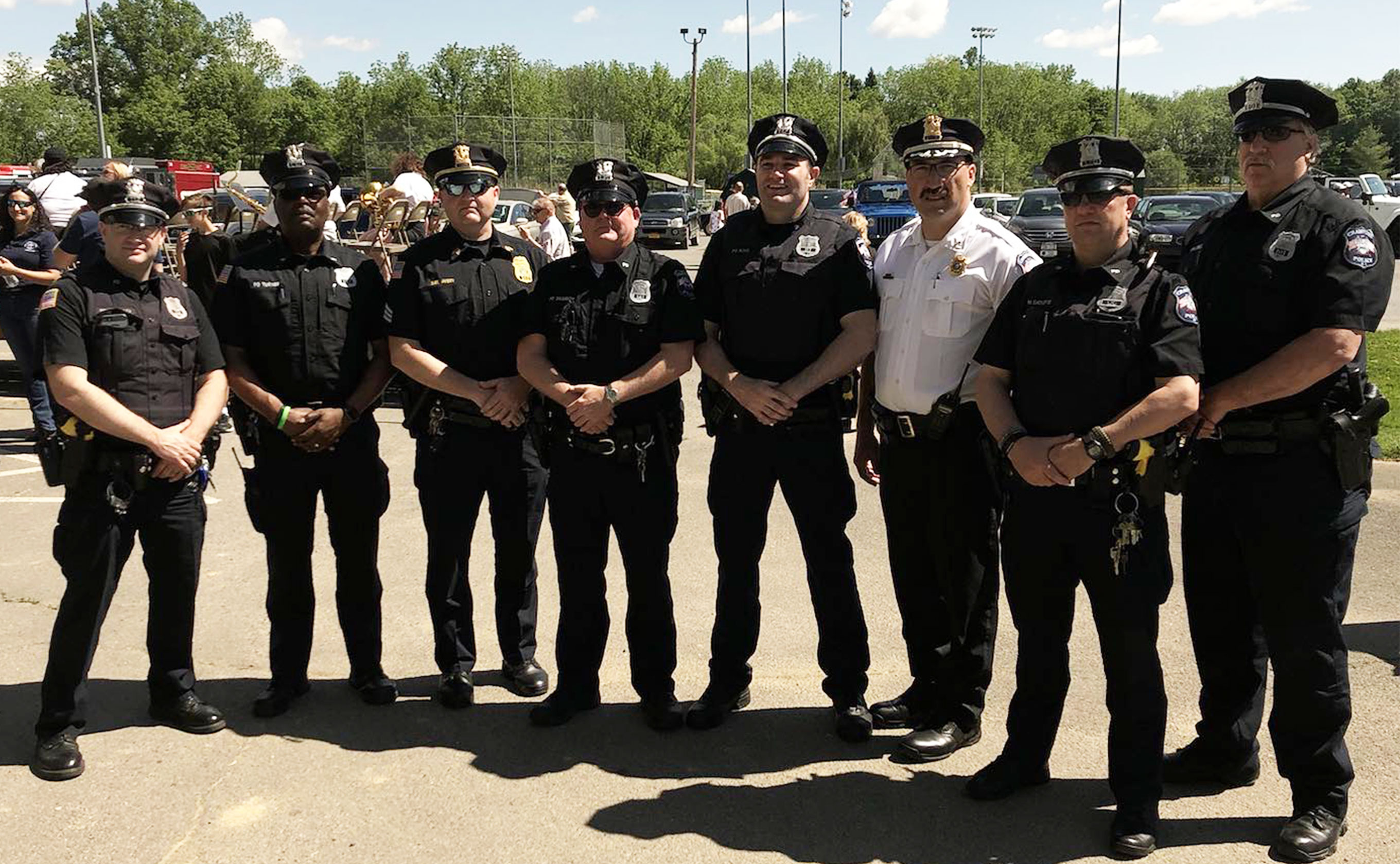 A large group of officers standing in a parking lot