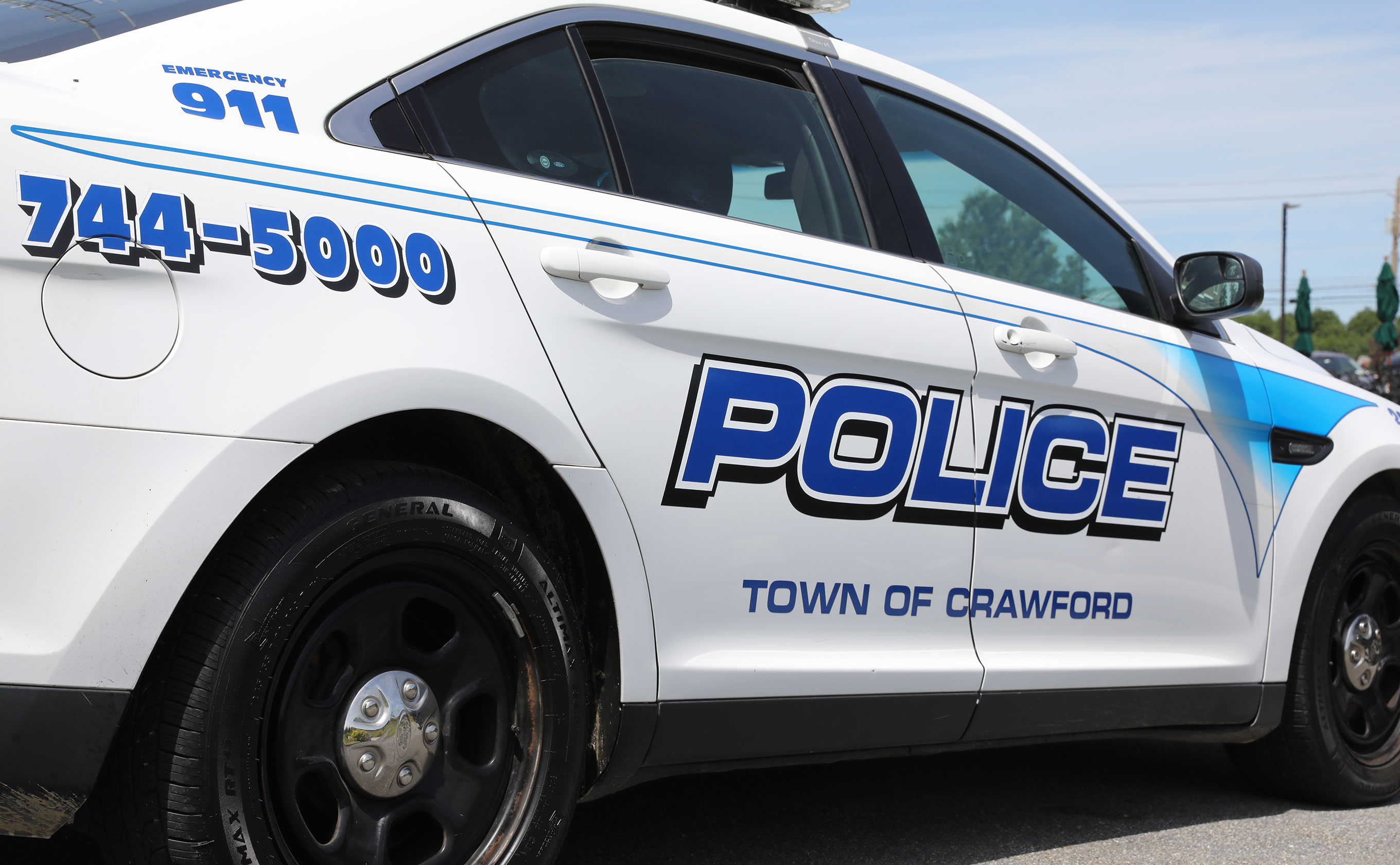 The side of a Town of Crawford police car
